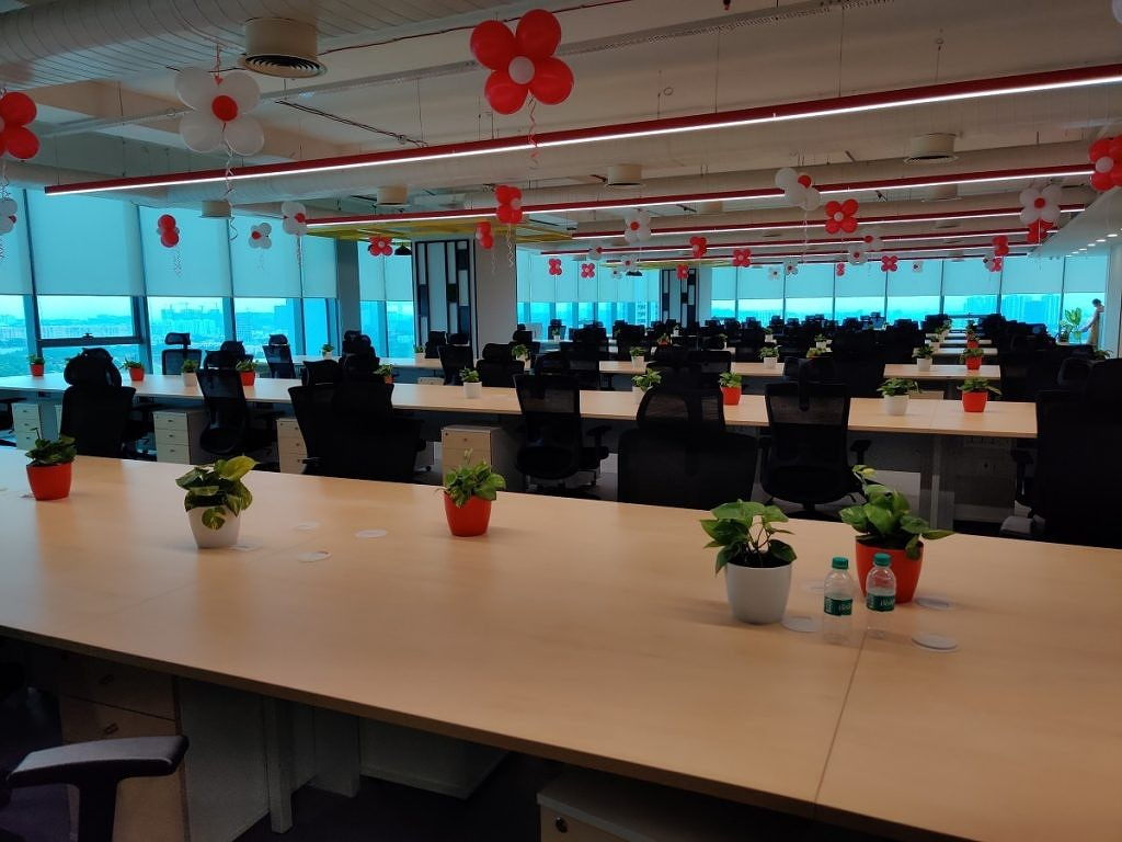 OnePlus India R&D Center in Hyderabad, showing chairs and common working area