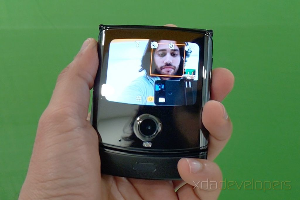 Taking a selfie with the Motorola Razr's small outside screen.