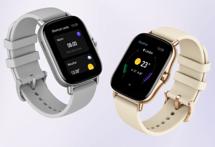 Amazfit GTS 2 gold and silver on lilac background