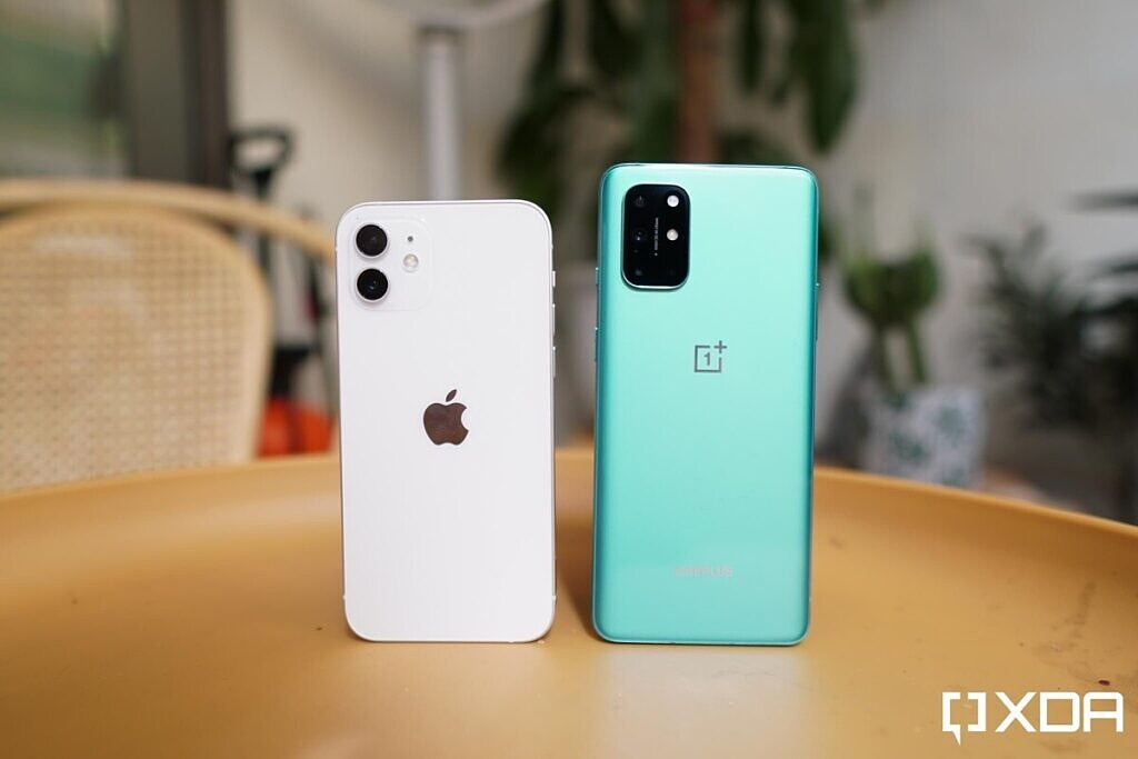 iPhone 12 and OnePlus 8T standing on a table