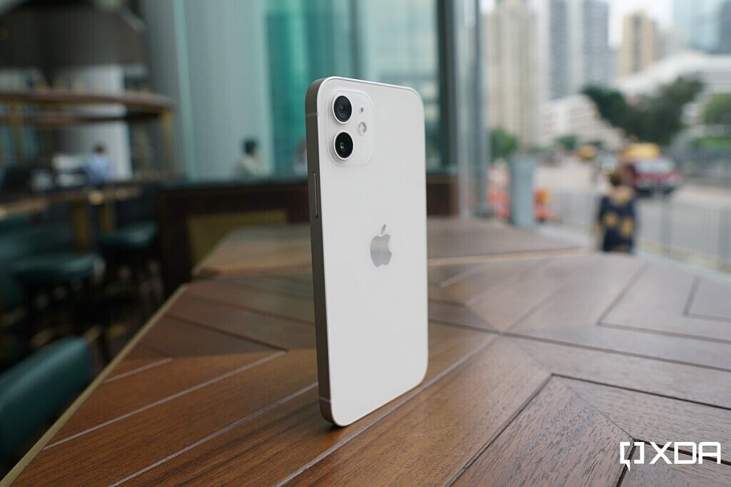 Apple's iPhone 12 in white standing on its own