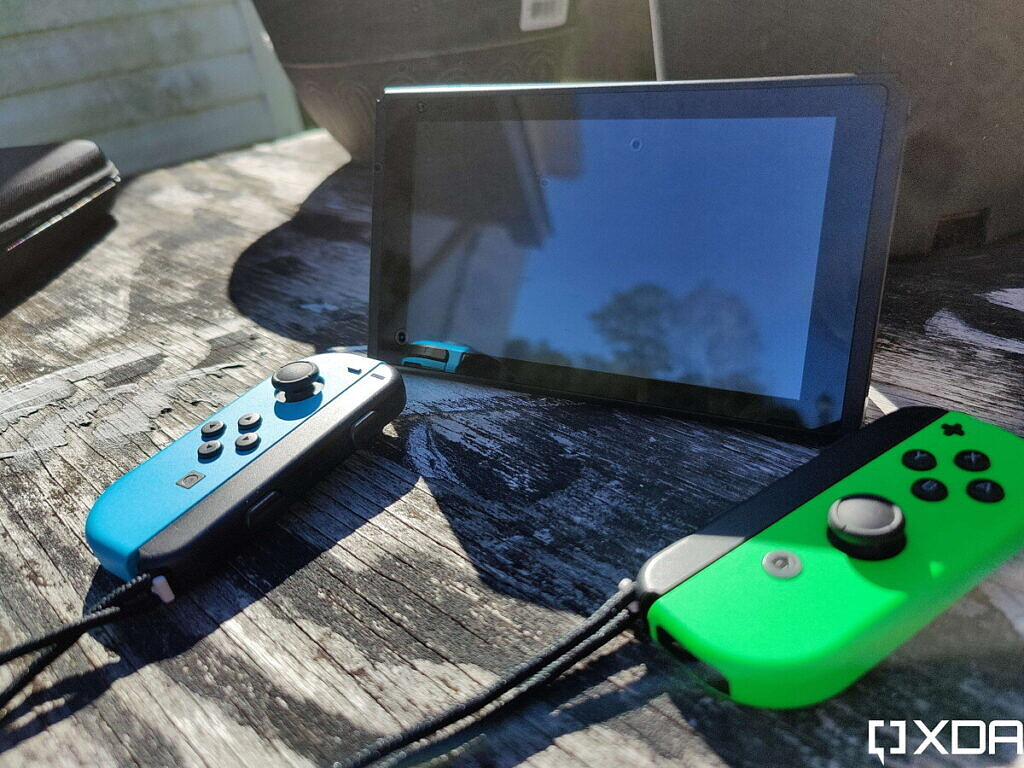 nintendo switcvh with joy-cons detached, outside