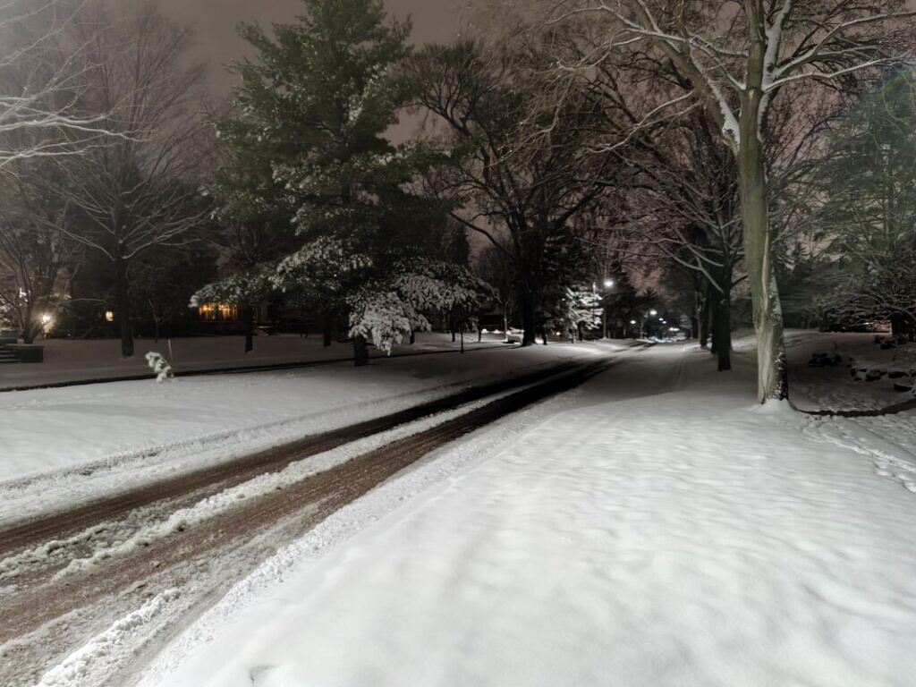 Night shot of a snowy landscape and road