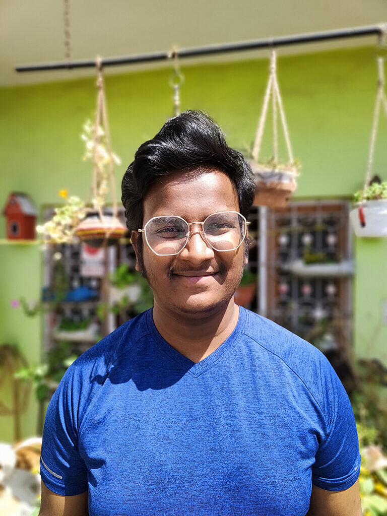 human portrait in front of plants clicked with Realme 8 Pro 108MP camera