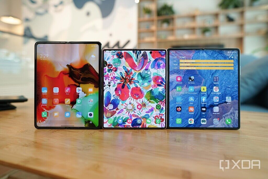 The Xiaomi Mi Mix Fold next to the Samsung Galaxy Z Fold 2 and the Huawei Mate X2 on top of a table in unfolded form.
