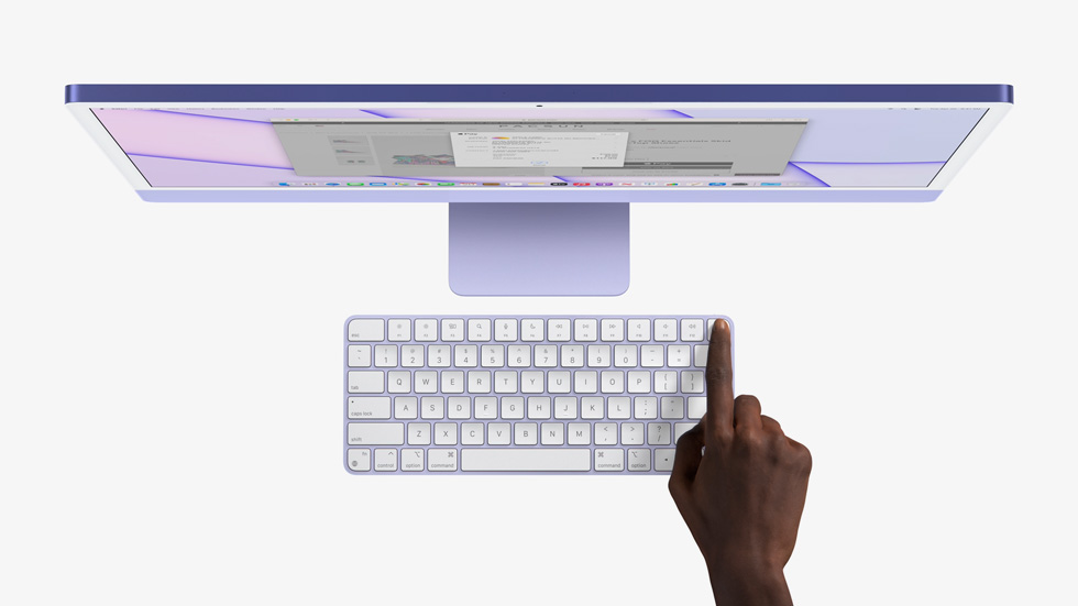 iMac and Magic Keyboard with hand pressing Touch ID