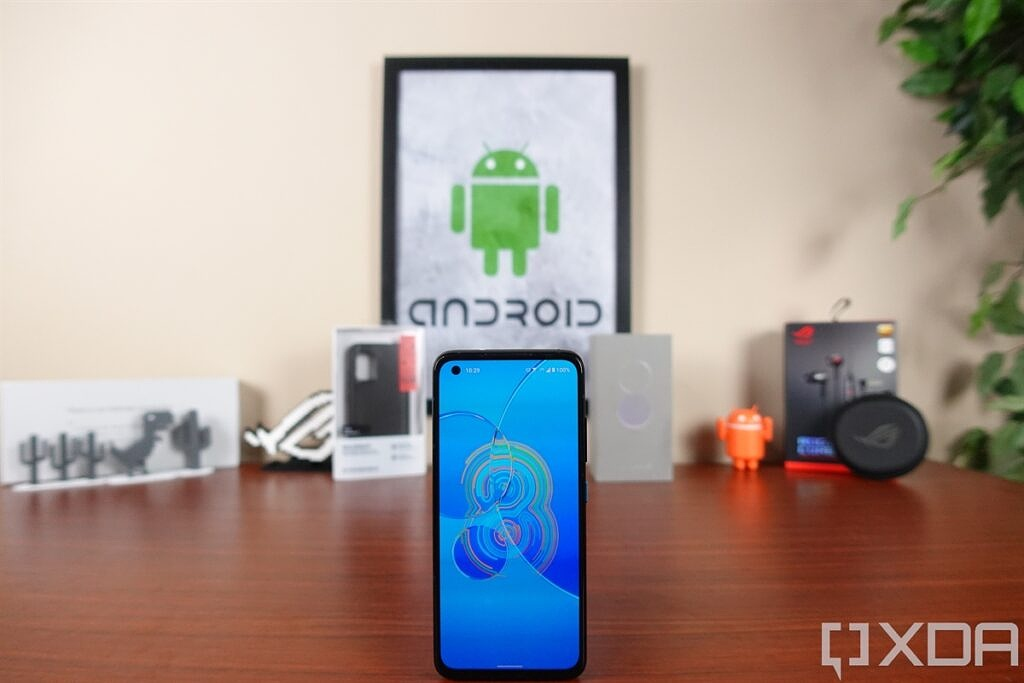 ASUS ZenFone 8 on a table in front of tech gear