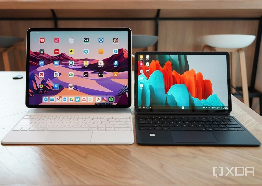 Apple's iPad Pro 2021 and the Galaxy Tab S7 on a table.
