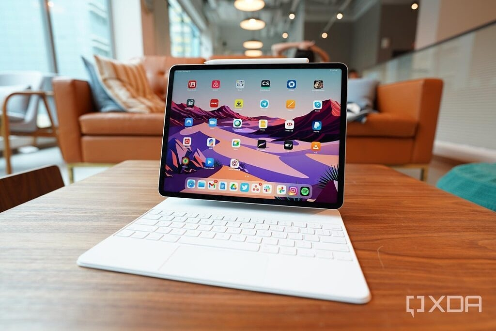 Apple's 2021 iPad Pro, 12.9-inch, with M1 processor and Magic Keyboard case and an Apple Pencil.