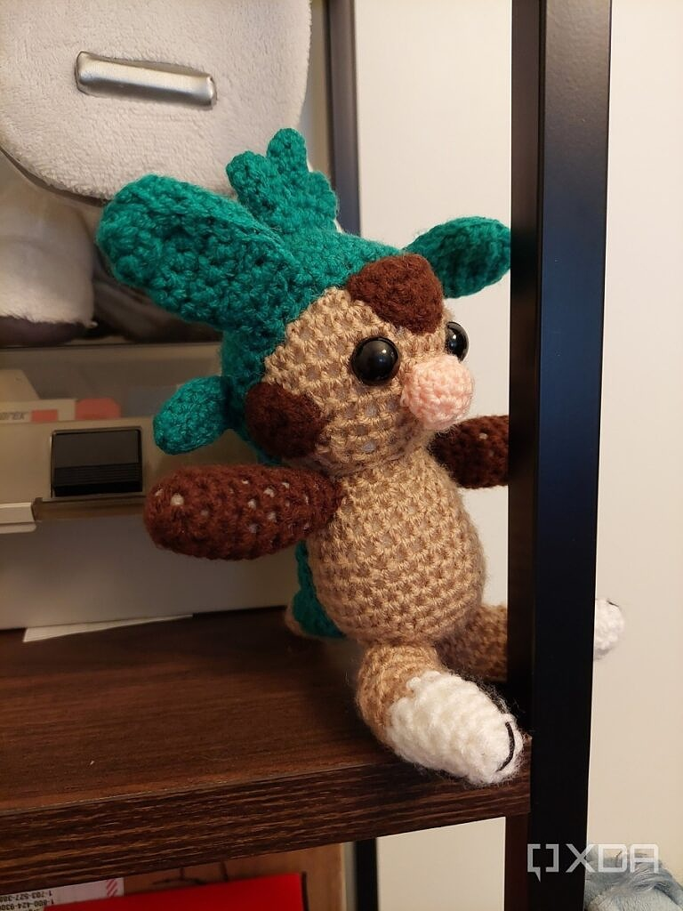 Photo of a knitted Chespin Pokemon on a shelf