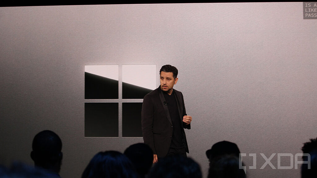 Panos Panay with Surface logo in background