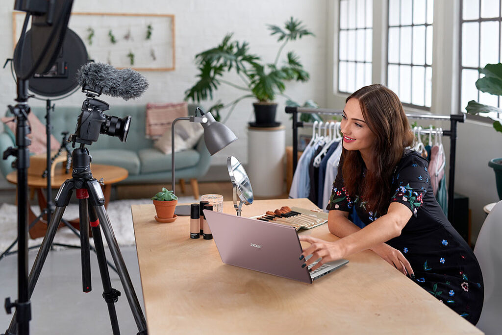Woman recording makeup video with Acer Swift X