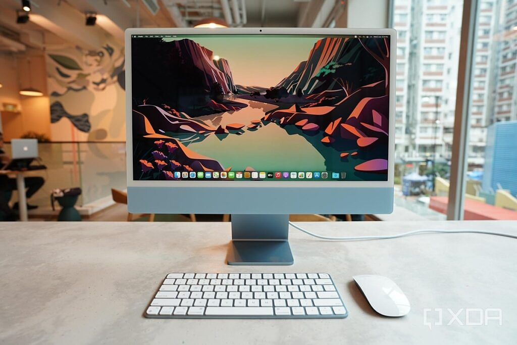 Apple's 2021 iMac in blue with matching accessories