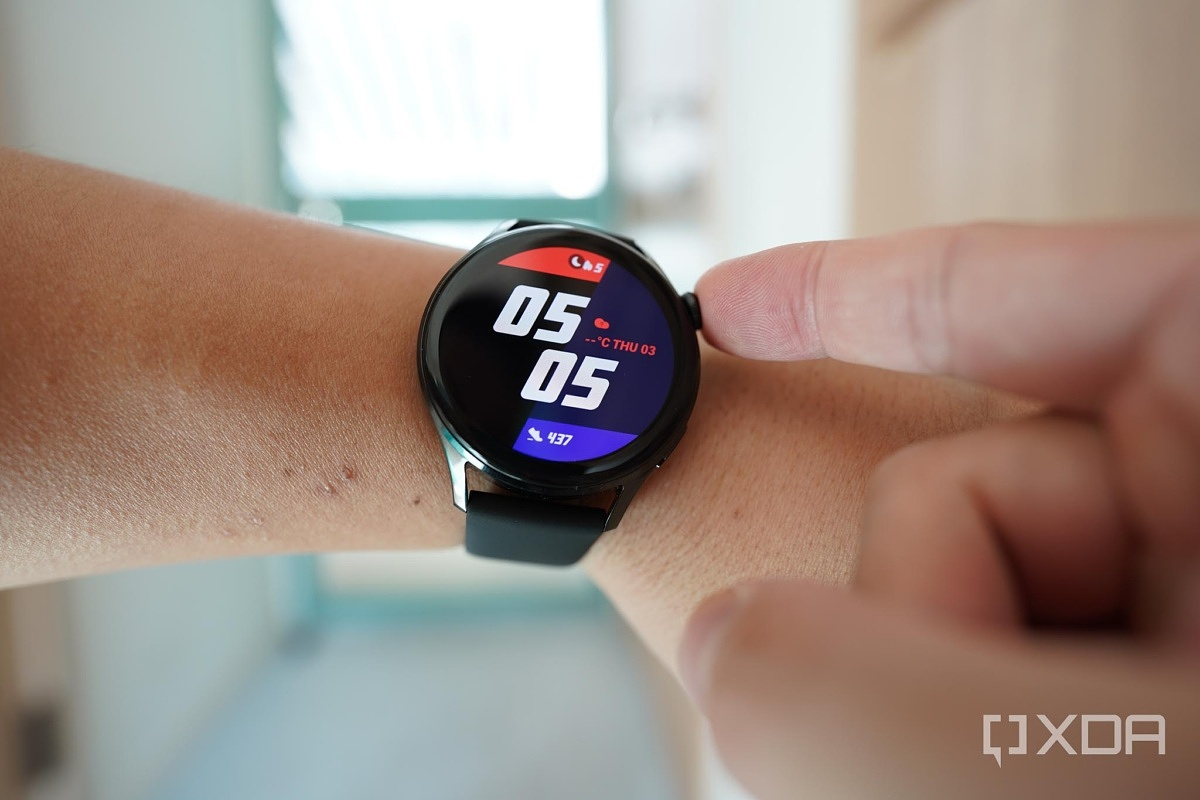 Pressing the digital crown button of the Huawei Watch 3.