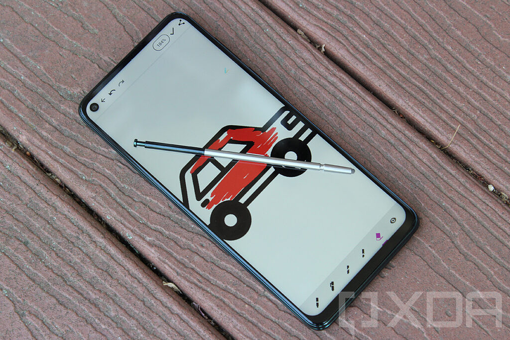 Moto G Stylus 5G with Coloring Book app open and pen on top