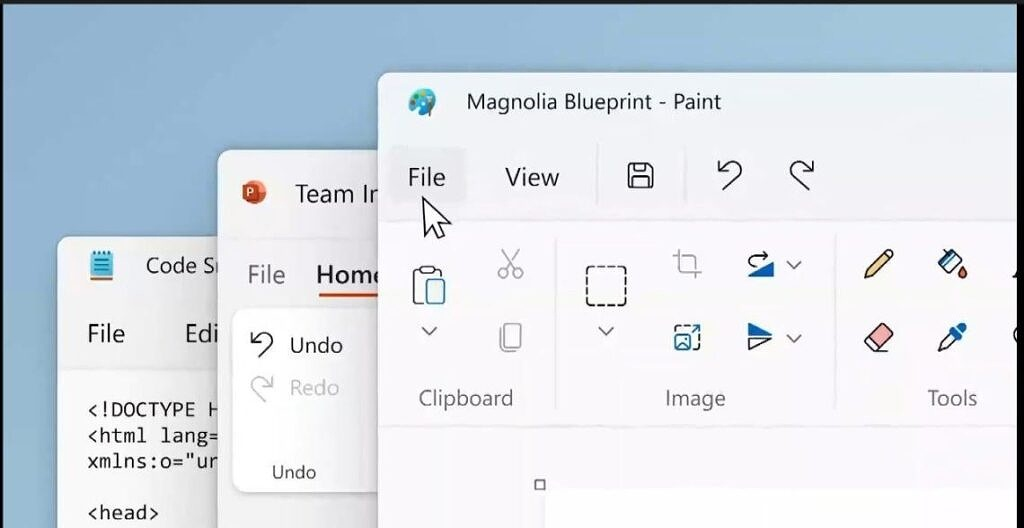 Notepad and Paint apps open on a PC