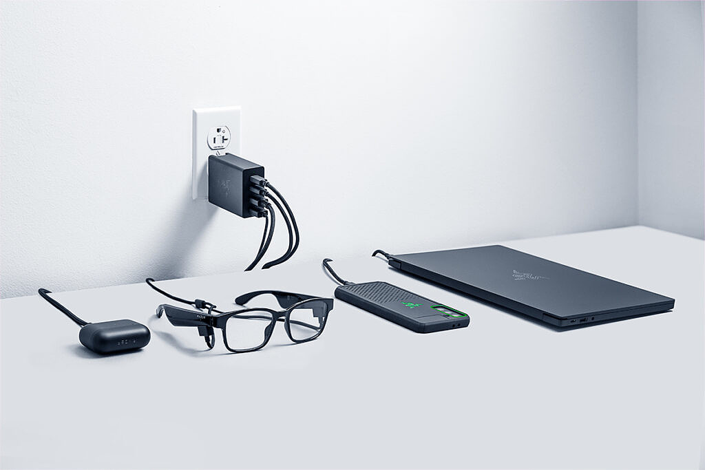 Razer Gan Charger connected to glasses, earbuds, phone, and laptop