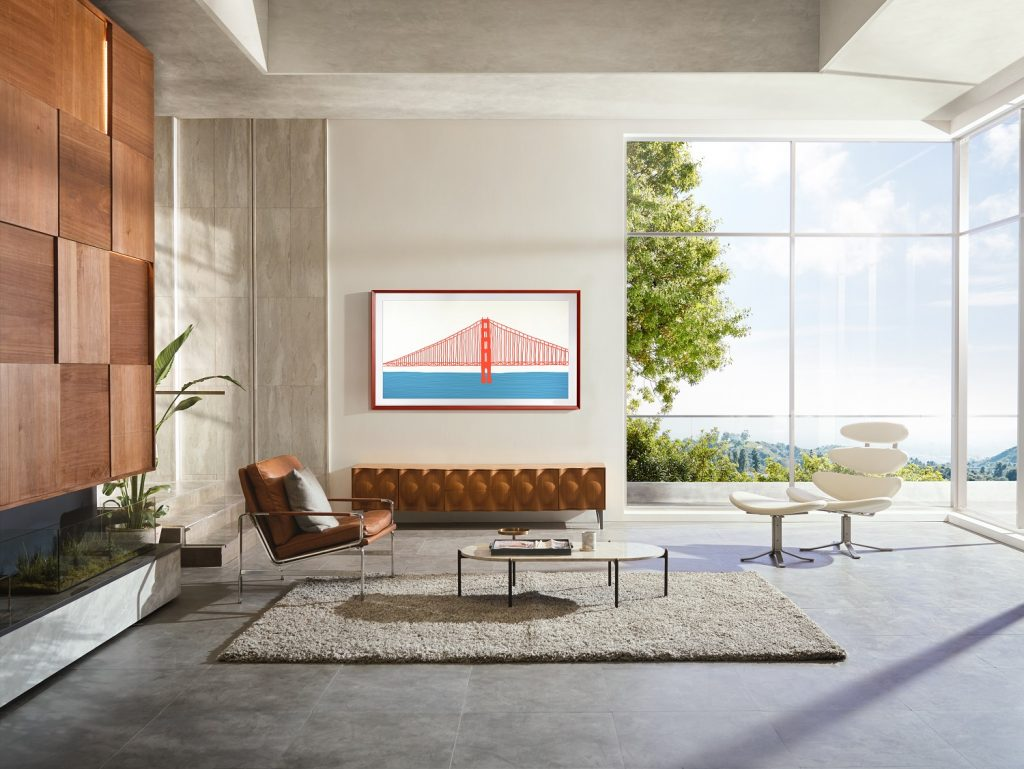 Samsung Frame TV 2021 in living room with modern chairs, coffee table and rug