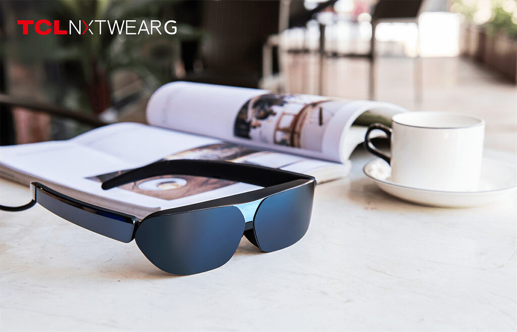 TCL NXTWEAR G glasses sitting on a table