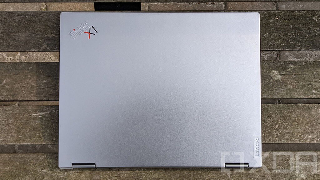 Top down view of ThinkPad X1 Titanium Yoga on wooden bench