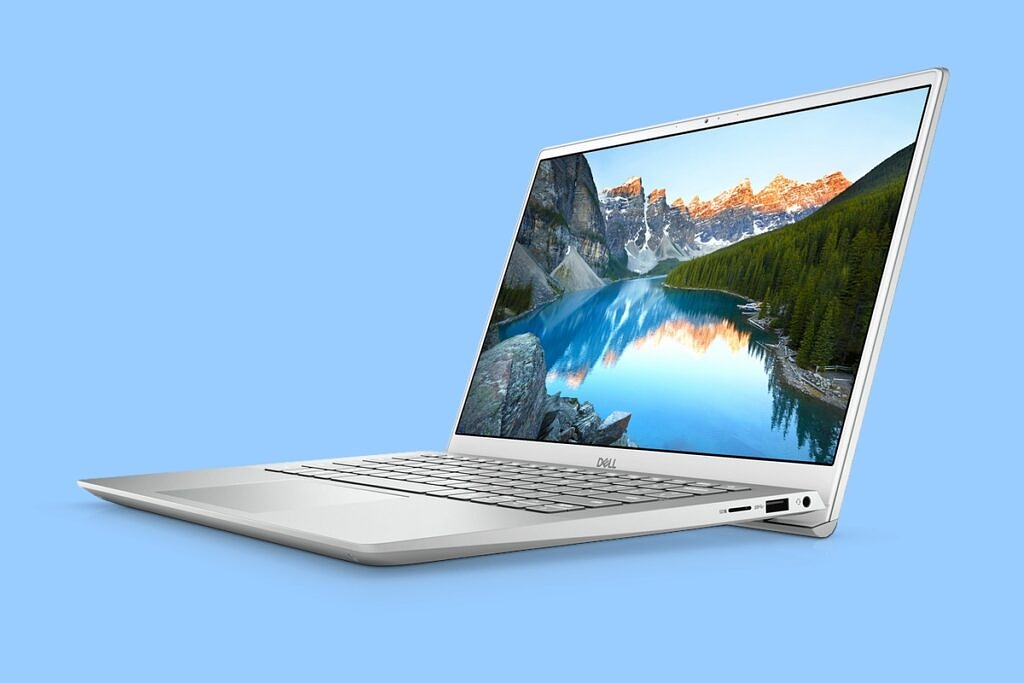 Dell Inspiron 14 on a light blue background