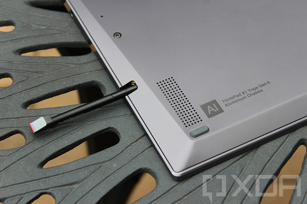 Closeup of ThinkPad X1 Yoga pen coming out of pen garage