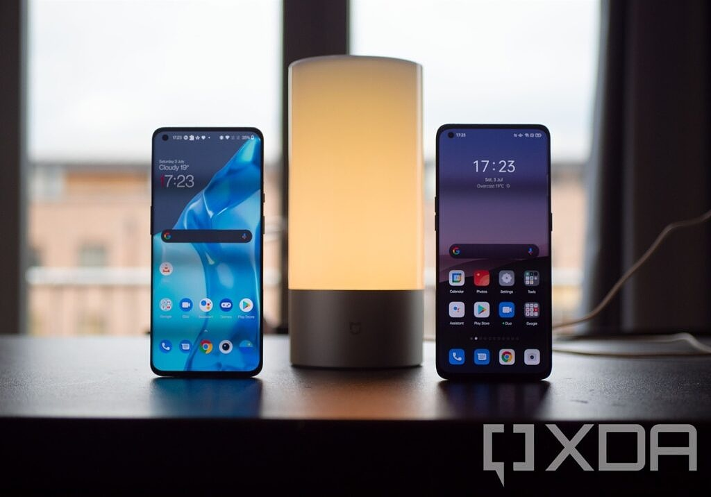 OnePlus 9 Pro and OPPO Find X3 Pro shown besides a table lamp