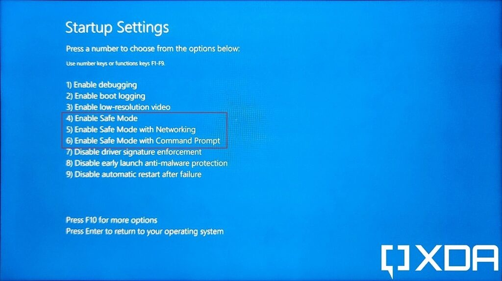 List of Windows 11 startup options in the UEFI menu with Safe Mode options highlighted