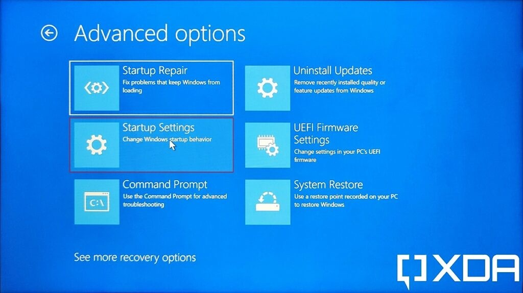 Windows 11 UEFI menu with Startup settings option highlighted to boot into Safe Mode