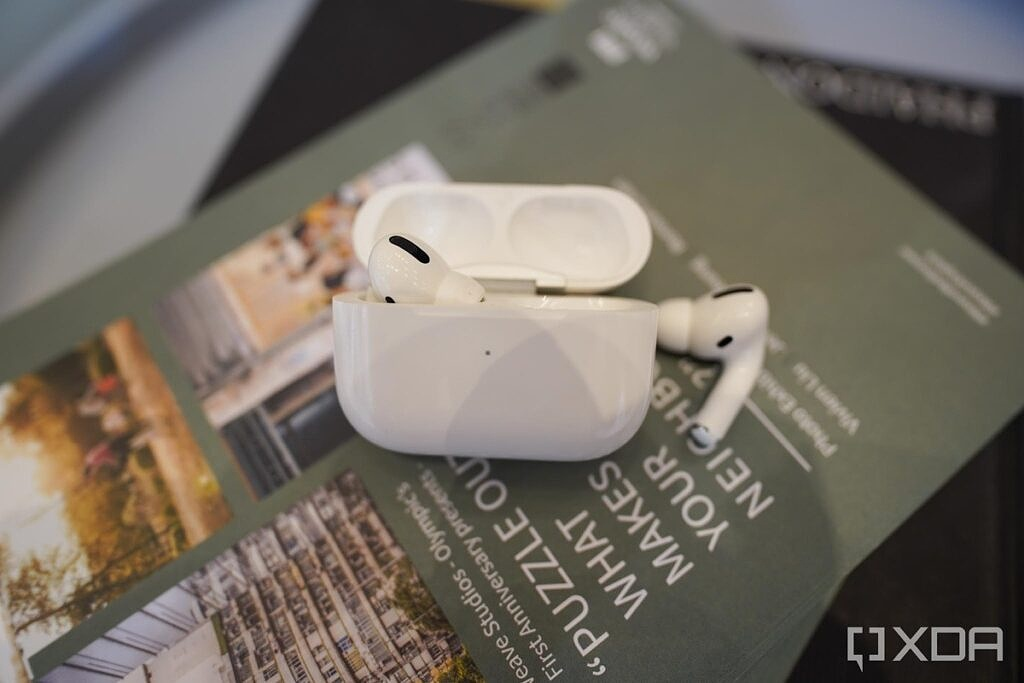 Apple AirPods Pro on a stack of magazines.