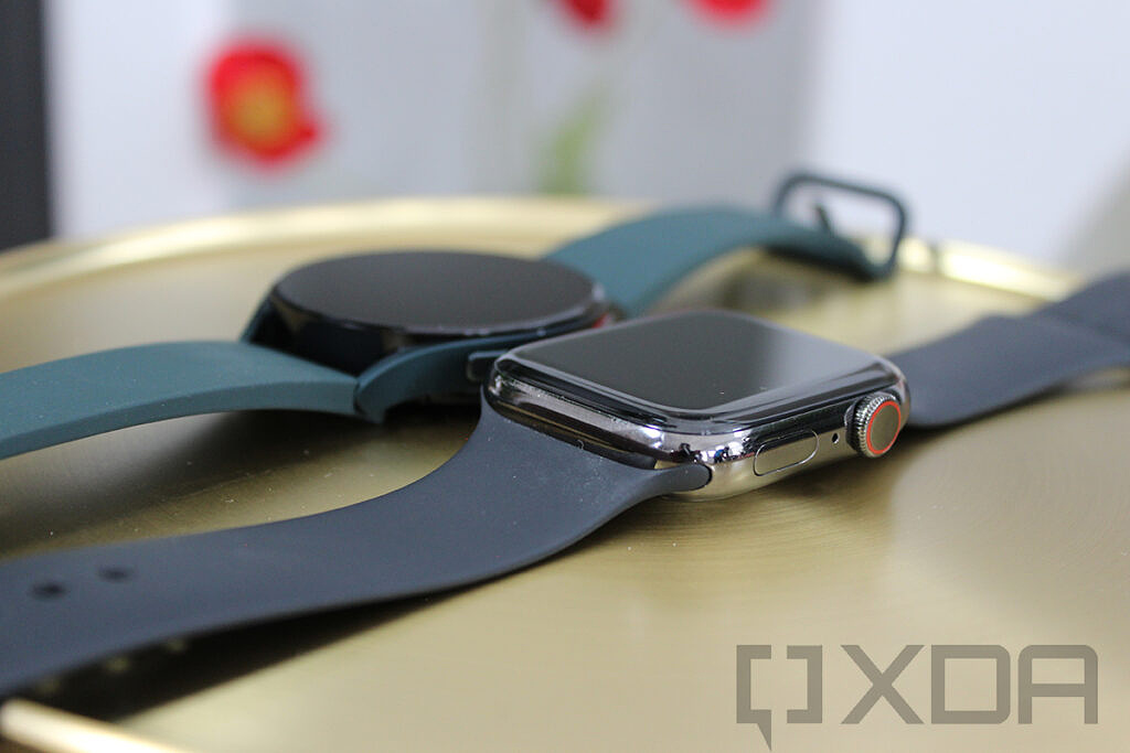 Angled view of Apple Watch and Samsung Galaxy Watch 4