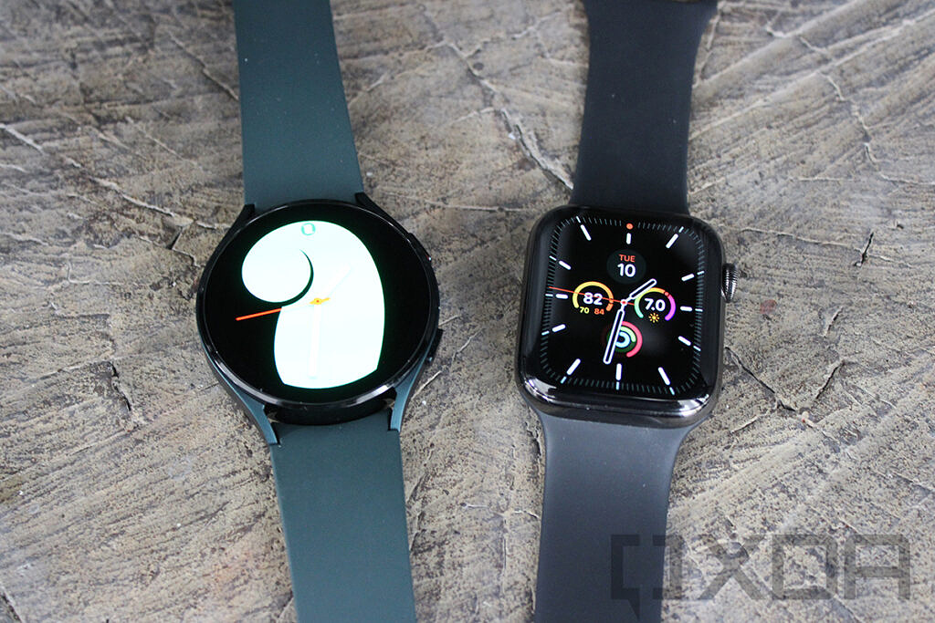 Top-down view of Apple Watch and Samsung Galaxy Watch 4