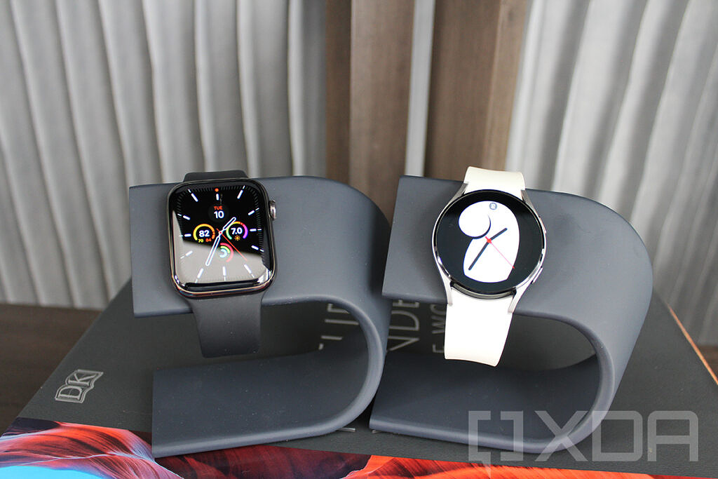 Apple Watch and Samsung Galaxy Watch 4 on watch stands
