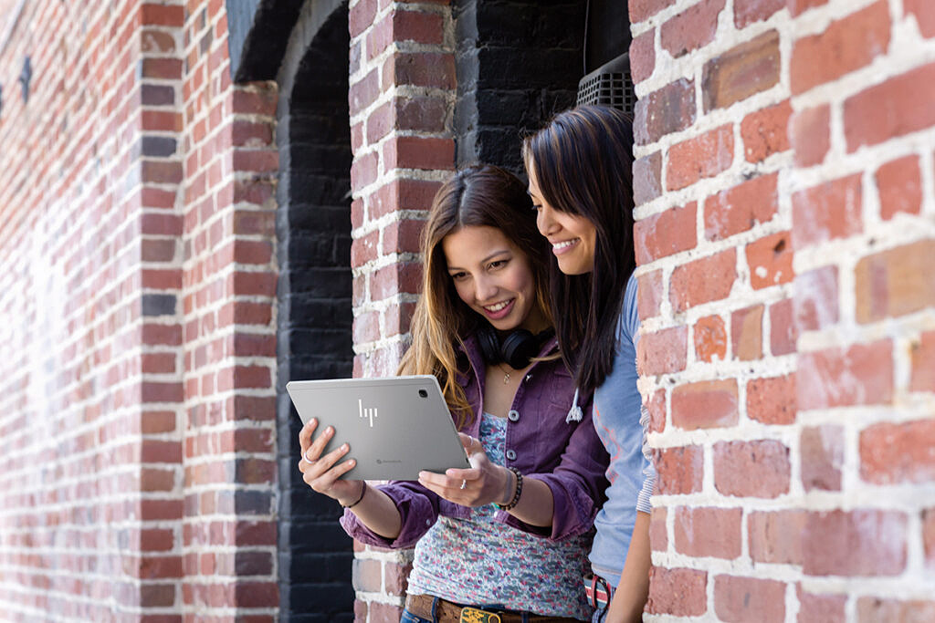 Two women looking at the HP Chromebook x2 11