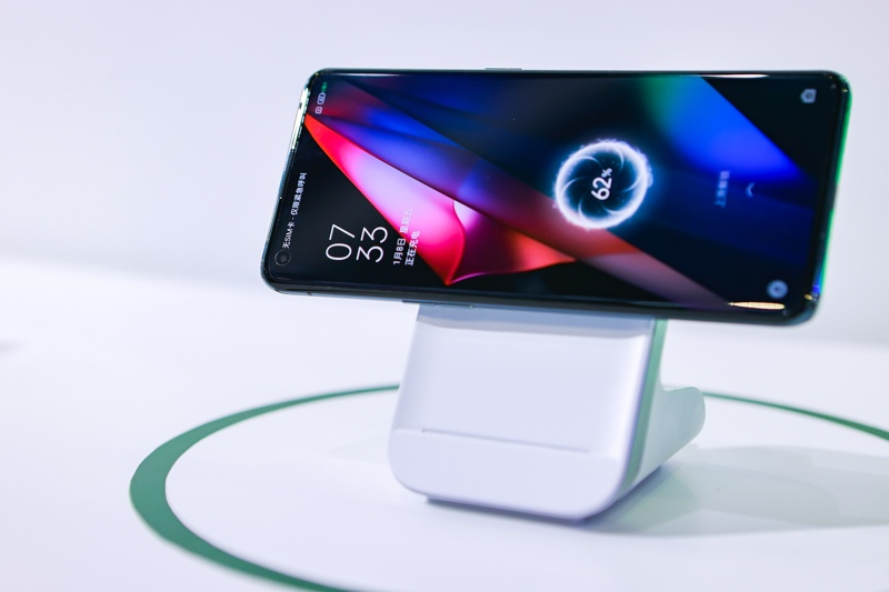 A phone attached to a wireless charging stand