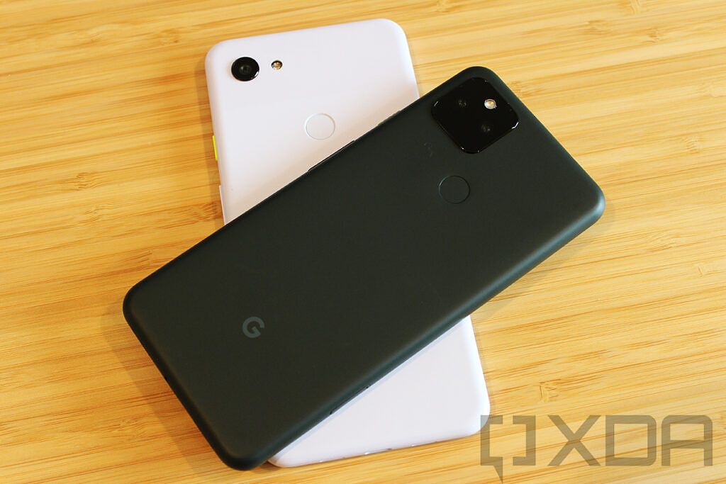 Google Pixel 5a on top of Pixel 3a XL on wooden table