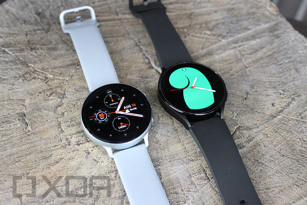 Samsung Galaxy Watch 4 and Galaxy Watch Active 2 side by side on wooden surface