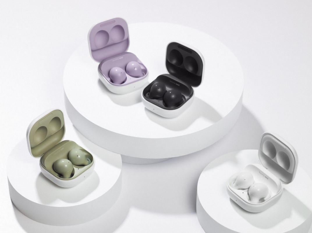 Samsung Galaxy Buds 2 in Graphite Black, Lavender Purple, Olive Green, and White, kept open in their cases