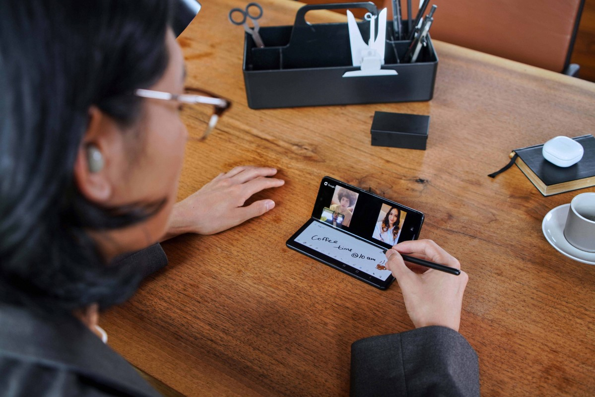 Samsung Galaxy Z Fold 3 being used in video call in Flex Mode, to take notes