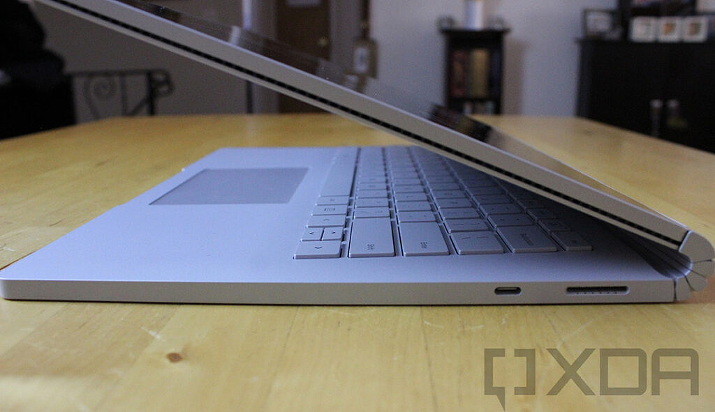 Surface Book 2 partially closed on wooden table