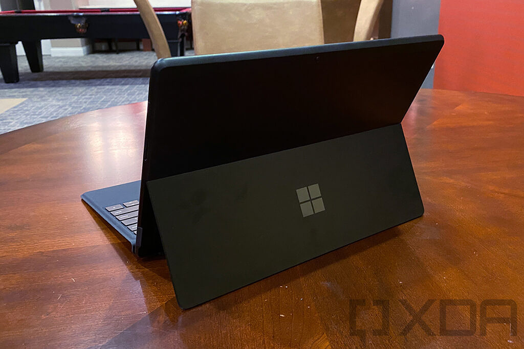 Surface Pro X in black on wooden table