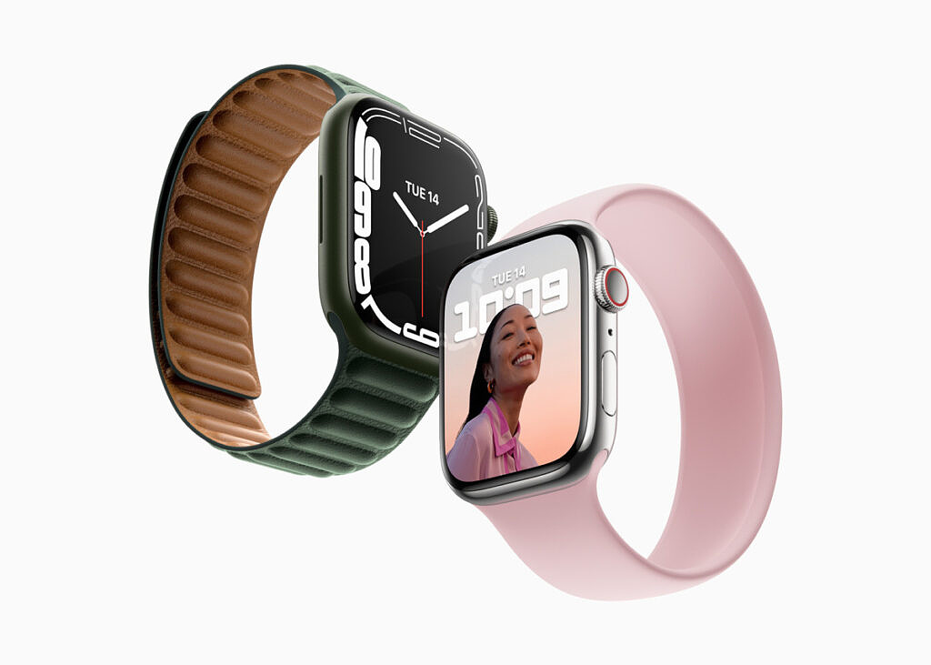 Apple Watch Series 7 with pink and green bands on white background