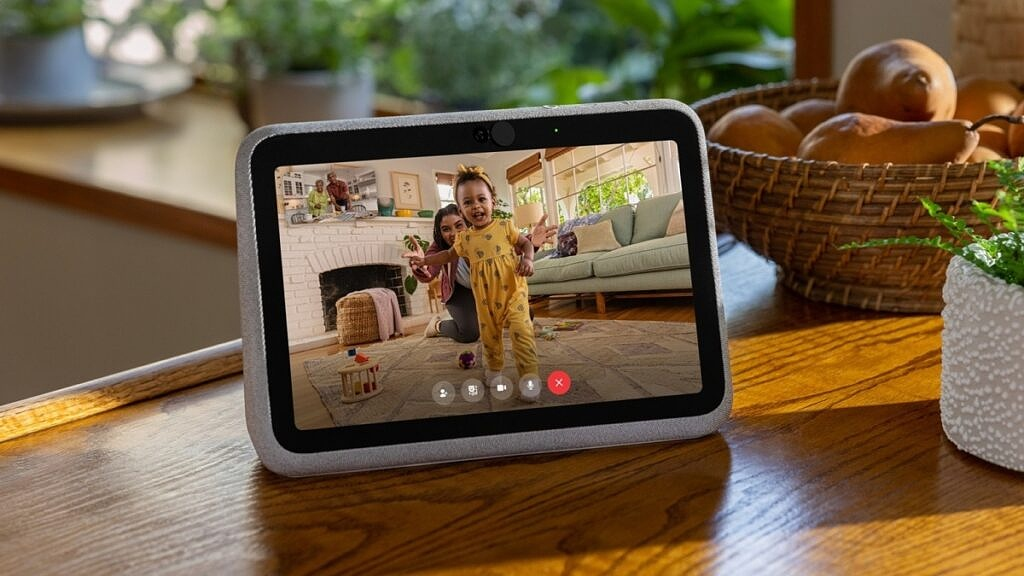 Facebook's Portal Go smart display sitting on a table with the screen showing an on-going video call