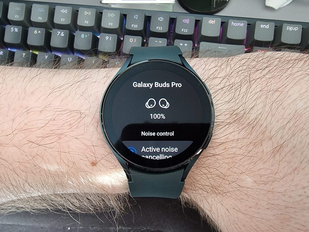 Galaxy Watch 4 on hand with Galaxy Buds controls on screen