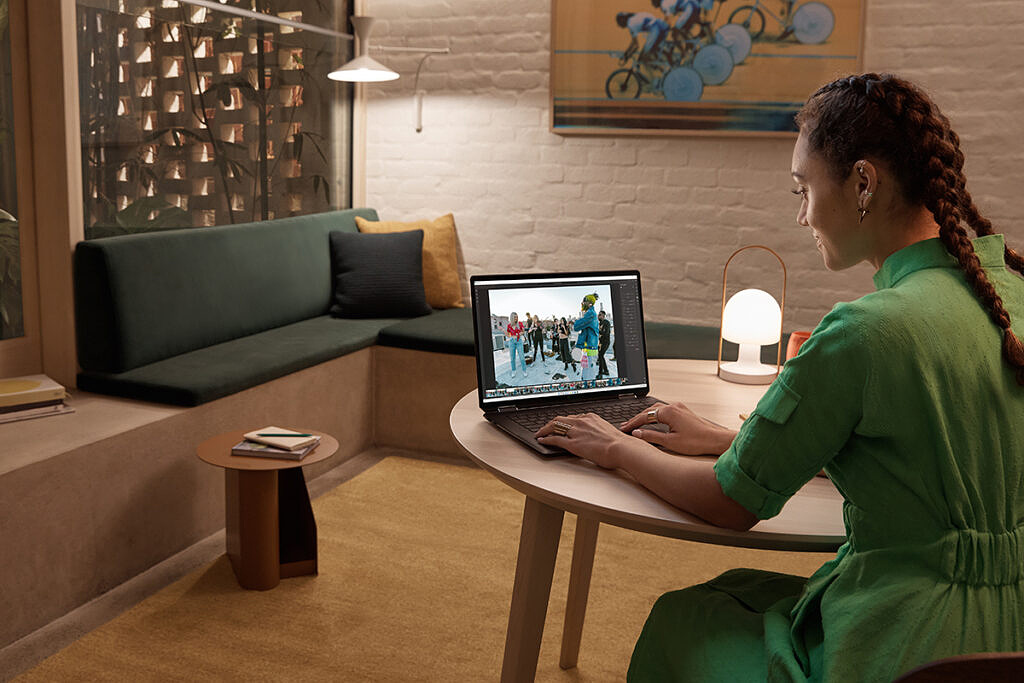 Woman sitting and using HP Spectre x360 16