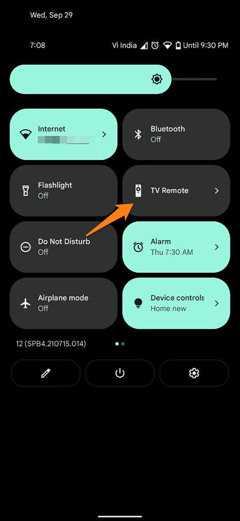 Android Quick Settings with arrow pointing at TV Remote tile