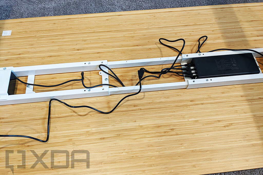Upside down desk with cables plugged into it