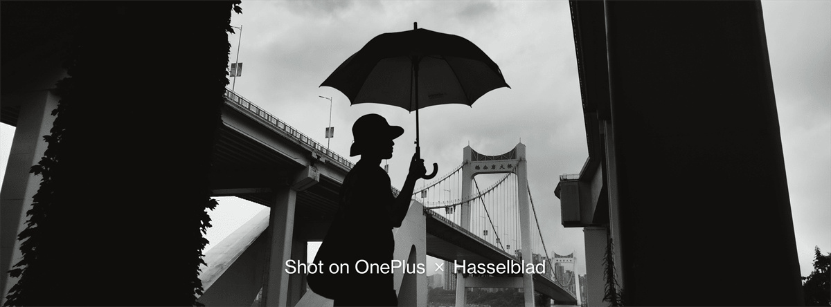 A black and white photo showing a man with umbrella