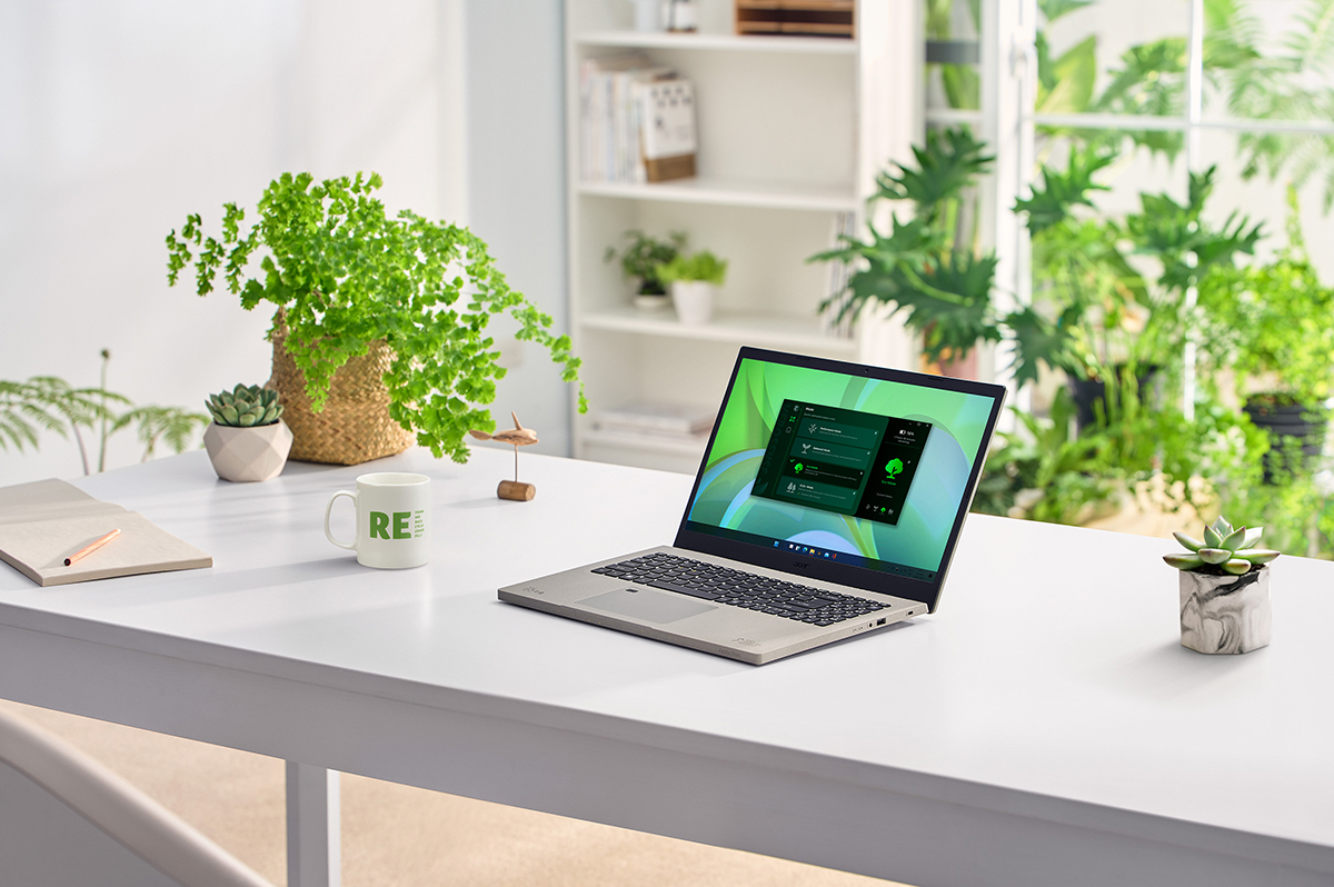 Laptop on white table with plants