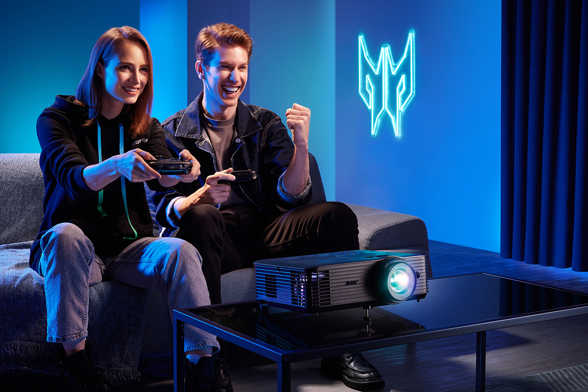 Woman gaming with man cheering on